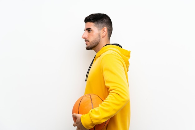 Handsome young basketball player man  on white wall Premium Photo