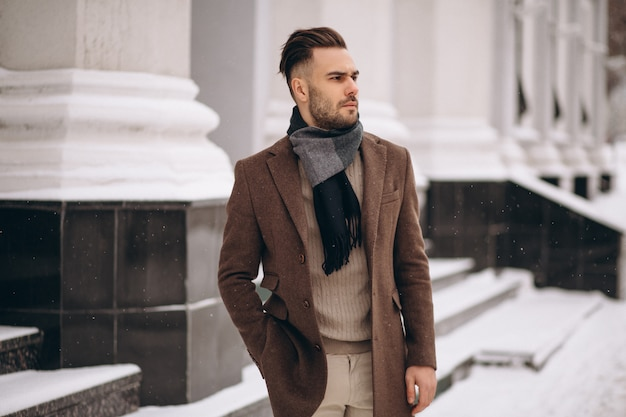 Handsome young business man outside in winter Free Photo