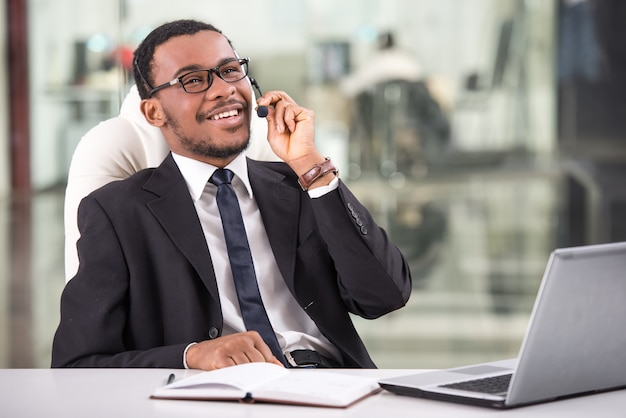 Handsome young businessman is taking a call. Premium Photo
