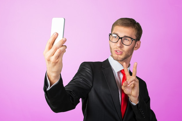 Handsome young businessman taking a selfie with a mobile phone Premium Photo