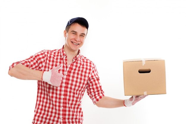Handsome young courier with brown box Free Photo