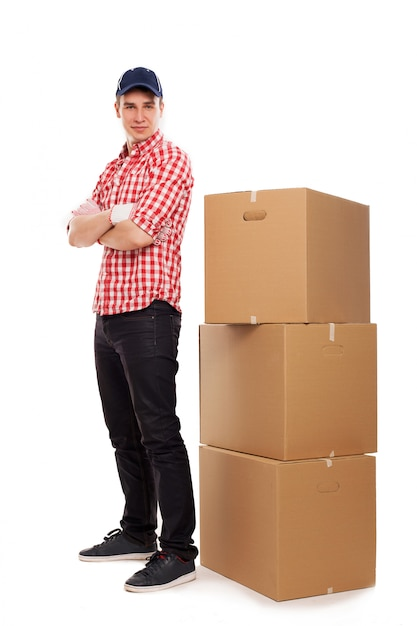 Handsome young courier with brown boxes Free Photo