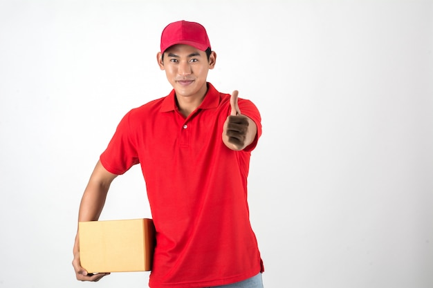 Handsome young delivery man with box isolated on white background. Free Photo