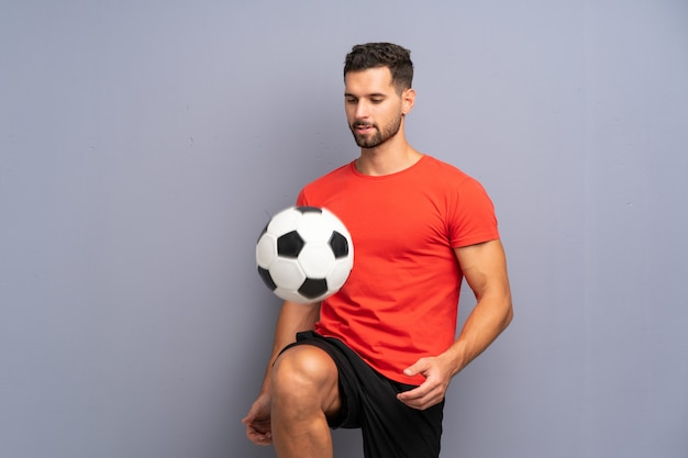 Handsome young football player man Premium Photo