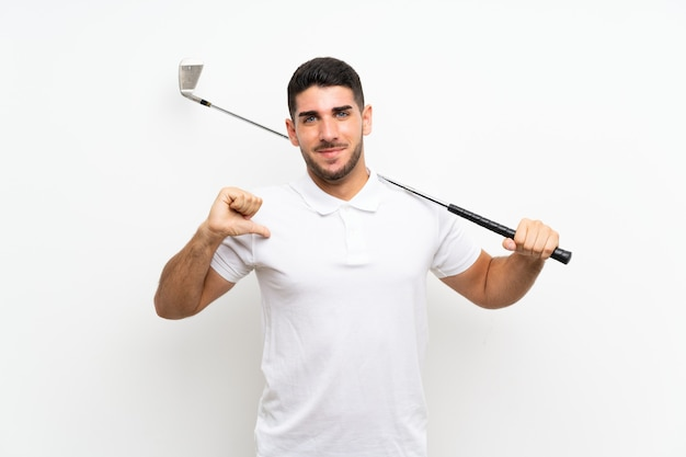 Handsome young golfer player man over isolated white proud and self satisfied Premium Photo