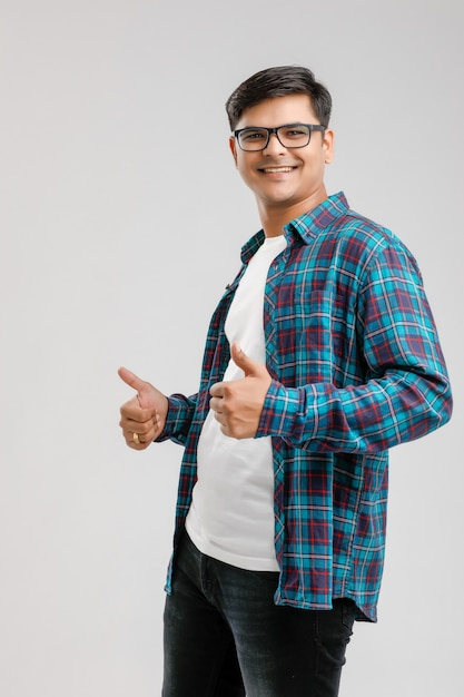 Handsome young indian man showing thumps up isolated Premium Photo