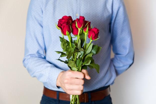 Image result for man holding rose bouquet
