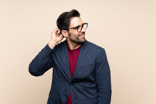 Handsome young man over isolated  thinking an idea Premium Photo
