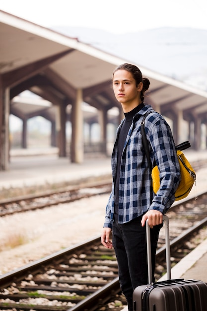 Handsome young man waiting for the train Free Photo