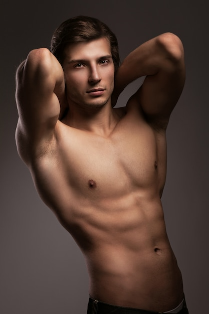 Handsome young man with naked torso Free Photo