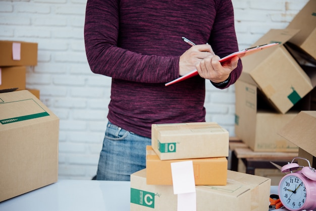 Handsome young man working with papers Free Photo