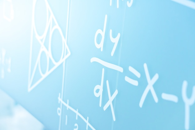 Handwriting physics equations sign on the college white board Premium Photo