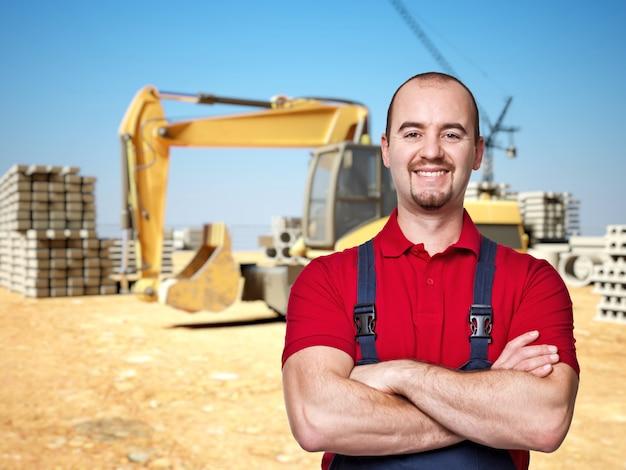 Handyman at construction site Premium Photo