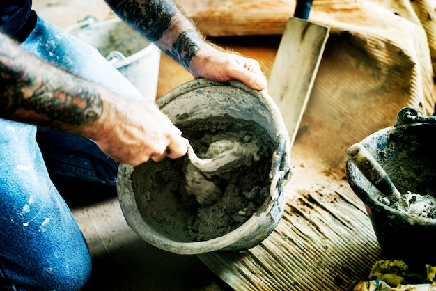 Handyman prepare cement use for construction Free Photo