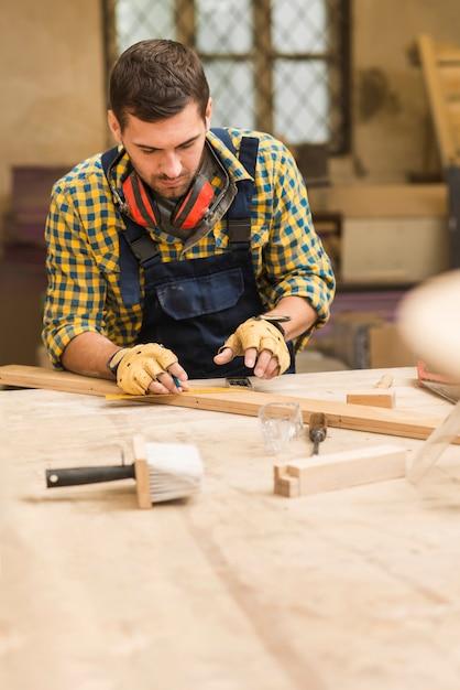 Handyman working in the workshop Free Photo