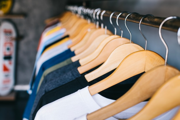 Hangers on clothes rail Free Photo