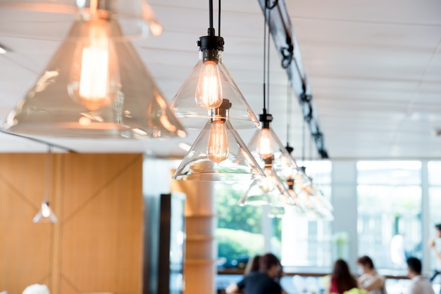 Hanging ceiling lights in a modern shared office space Premium Photo