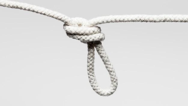 白いツイストコットンロープをぶら下げ 無料写真