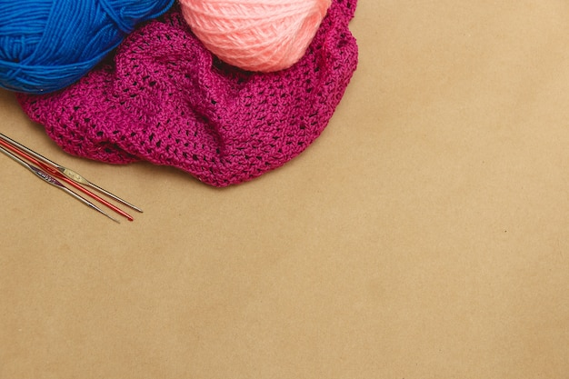 Hanks of bright yarn for knitting on a bright background Premium Photo