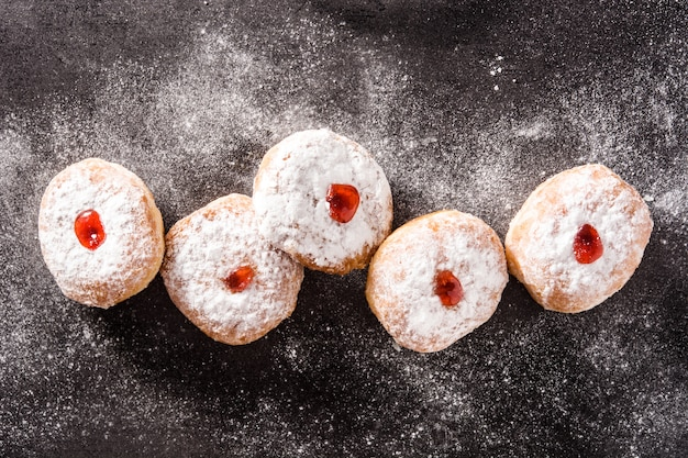 Hanukkah sufganiyot. traditional jewish donuts for hanukkah top view Premium Photo