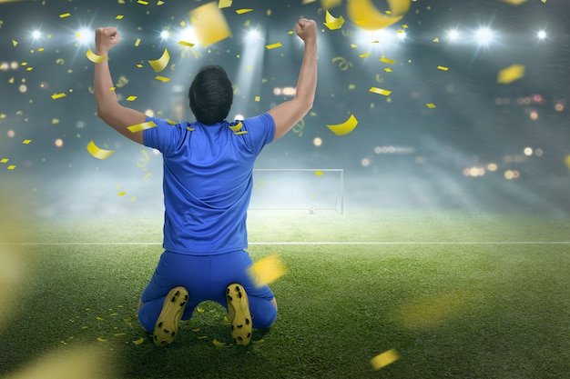 Happiness asian soccer player man after winning the match Premium Photo
