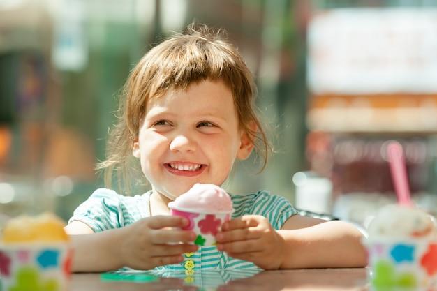 Happy 3 years girl eating ice cream Free Photo