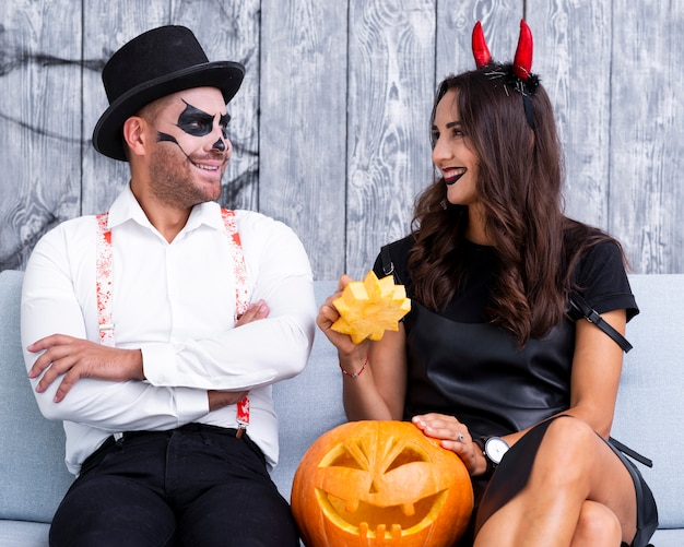 Happy adult couple together for halloween Free Photo