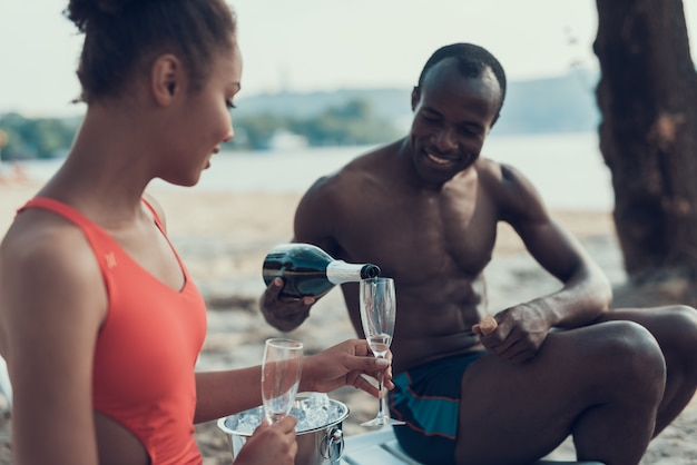 Happy afro-american couple of man and woman is resting. Premium Photo