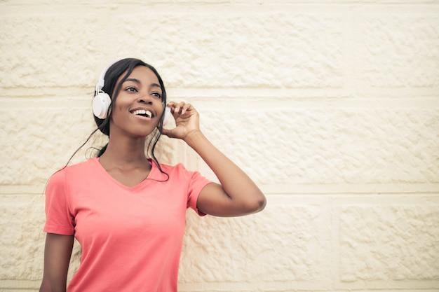 Happy afro girl listening to music Premium Photo
