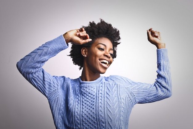 Happy afro woman dancing Premium Photo