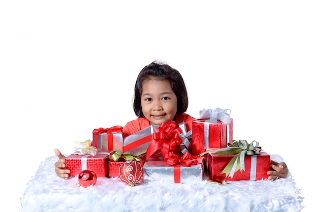 Happy asian child holding christmas presents. Premium Photo