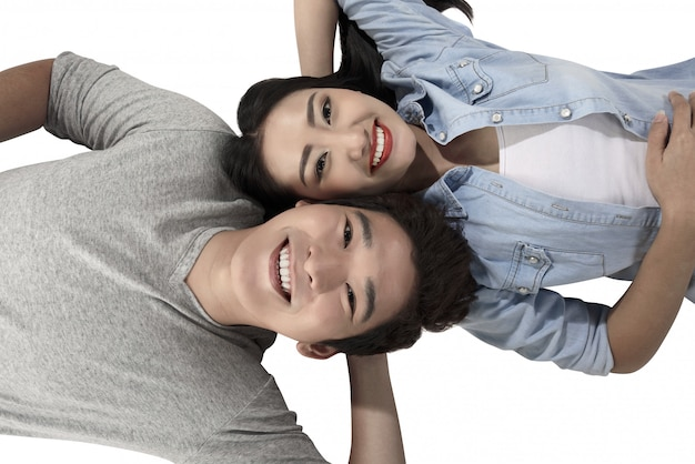 Happy asian couple isolated over white background Premium Photo