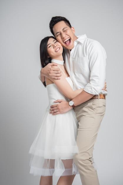 Happy asian couple in love embracing Premium Photo