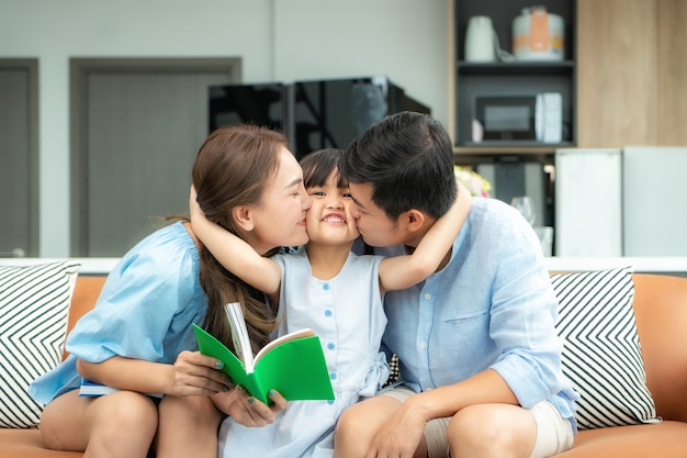 Happy asian family at home reading Premium Photo