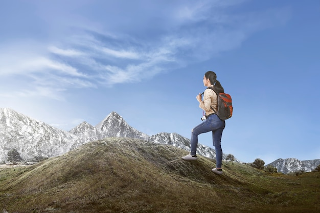 Happy asian female traveler with backpack walking Premium Photo