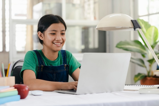 Happy asian girl learning online at home Premium Photo