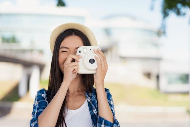 Happy asian girl takes photo summer memories. Premium Photo