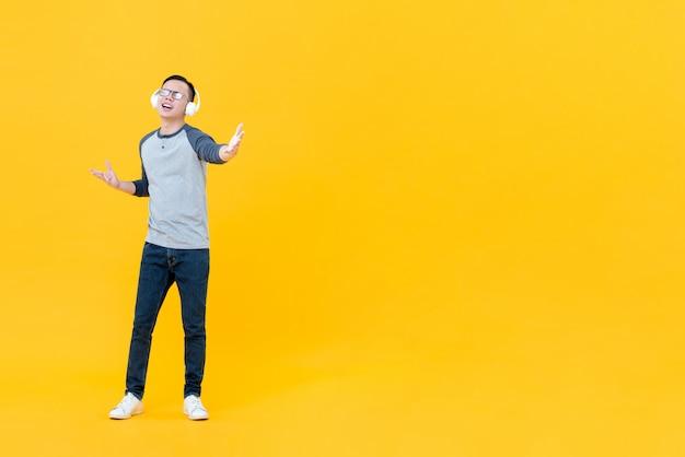 Happy asian man enjoyed listening to music on headphones Premium Photo