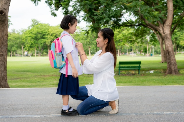 Happy asian mother with kids student in school. Premium Photo