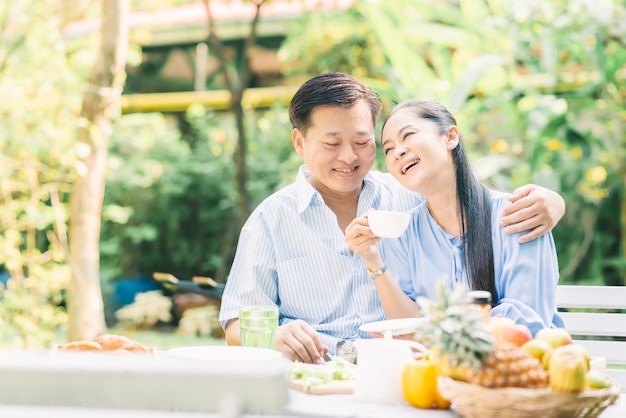 Happy asian senior couple laughing Premium Photo