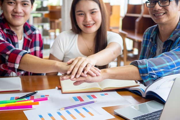 Happy asian students brainstorming together to learn and study mathematical statistics in the university classroom Premium Photo