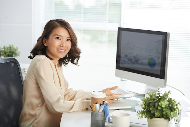 Happy asian woman at office Free Photo