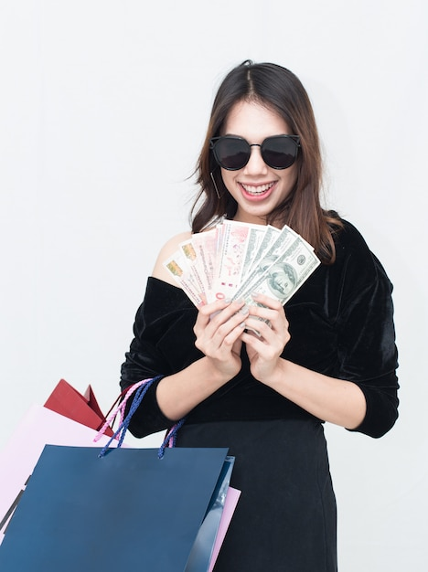 Happy asian women with shopping bag and holding money Premium Photo