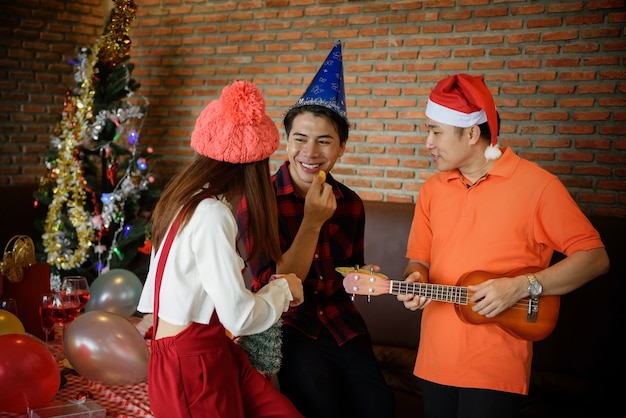 Happy asian young friends celebrate christmas party Premium Photo