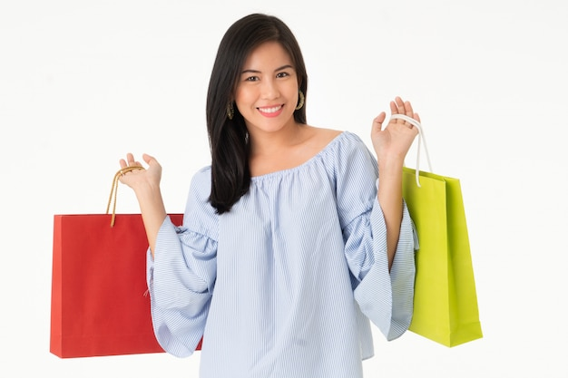 ba59ecf202b35 Happy asian young woman carrying shopping bags isolated Premium Photo