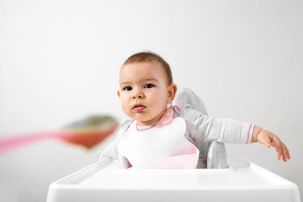 Happy baby toddler in high chair with spoon in his hand Premium Photo  sc 1 st  Freepik & Happy baby toddler in high chair with spoon in his hand Photo ...