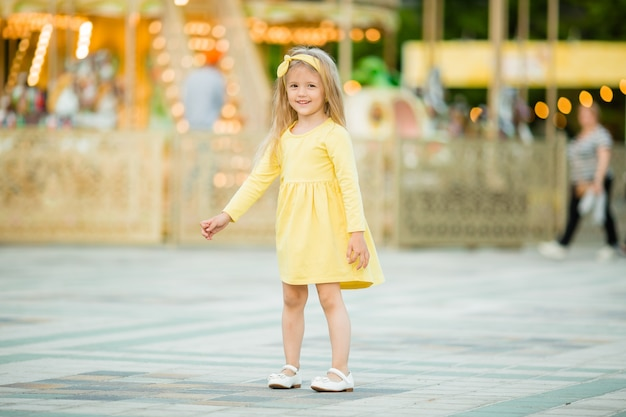 Happy baby walking in the park Premium Photo