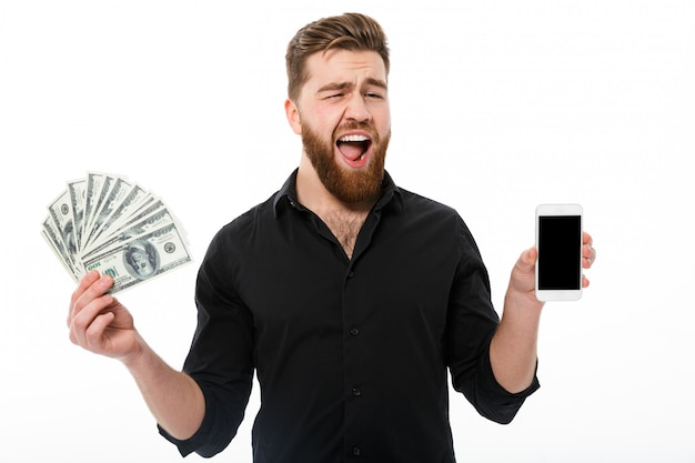 Happy bearded business man in shirt holding money Free Photo