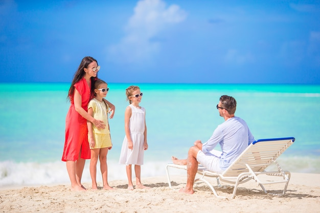 Happy beautiful family on a tropical beach vacation Premium Photo