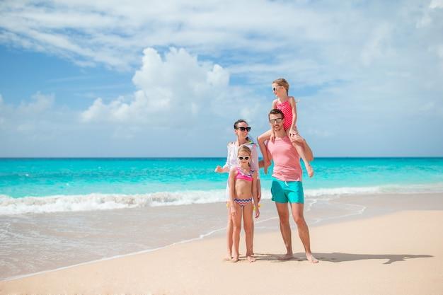 Happy beautiful family on white beach Premium Photo